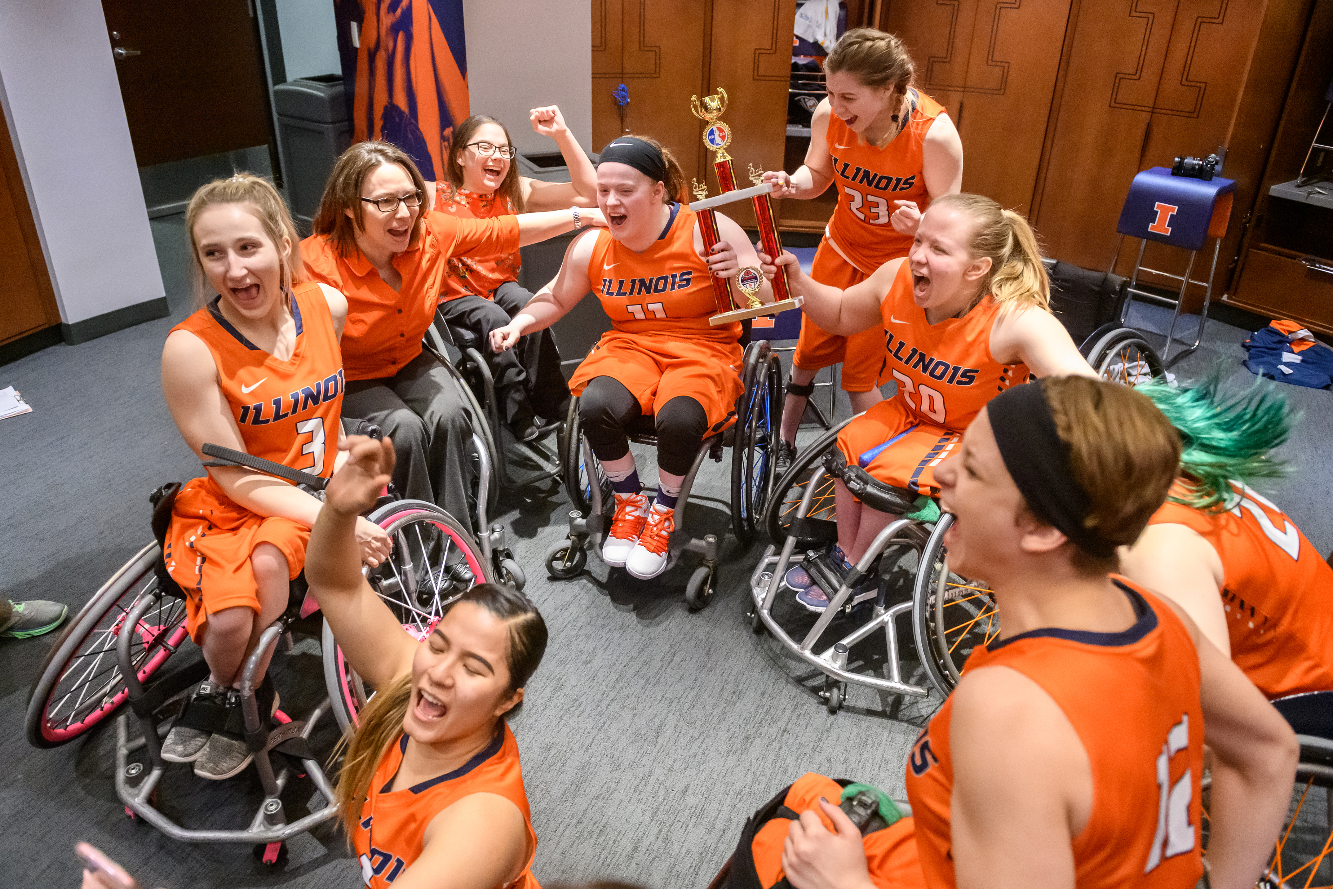 Illinois Women's Wheelchair Basketball Celebrating their 3rd place win in the locker room at State Farm Center
