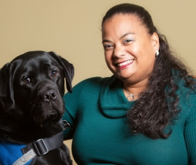 Picture of Dr. Forber-Pratt and her service dog