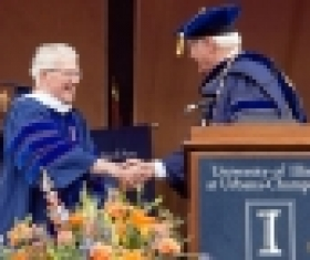 Dr. Tim Nugent shaking hands with University of IL President Bob Easter